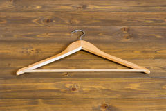 Wooden hanger on a dark table. Wooden hanger with the free Stock Photos