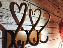 Wooden Hanger with a shadow in the shape of a heart royalty free stock image