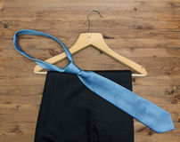 Wooden hanger with  tie and trousers Stock Images