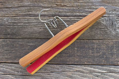 Wooden hanger for trousers Stock Photos