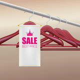 Wooden hangers with advertising label Stock Image