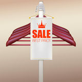 Wooden hangers with advertising label Royalty Free Stock Photos