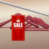 Wooden hangers with advertising label. Stock Images