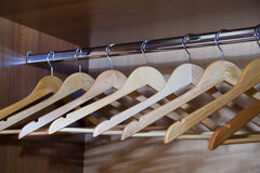 Wooden hangers for clothes. Hanging in the closet stock image