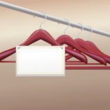 Wooden hangers with  label Royalty Free Stock Photos