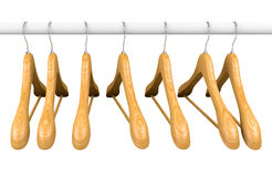 Wooden hangers on rail 1 Stock Photos