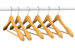 Wooden hangers on rail 2 Royalty Free Stock Photo