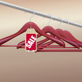 Wooden hangers with sale tag Royalty Free Stock Images