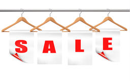 Wooden hangers with sale tags. Stock Images