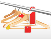 Wooden hangers with sale tags and stickers Royalty Free Stock Photo