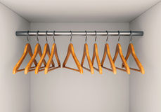 Wooden hangers in wardrobe Royalty Free Stock Photo