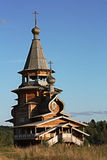 Wooden сhapel in the field. Royalty Free Stock Photography