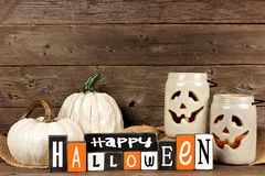 Wooden Happy Halloween sign with white decor. Wooden Happy Halloween sign with rustic white decor against an old wood background Royalty Free Stock Photos