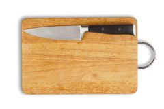 Wooden hardboard and kitchen knife Royalty Free Stock Photography