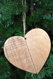 Wooden hart. On the christmas tree stock photos