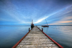 Wooden haven in the bay of Puck and boat Stock Photos