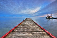 Wooden haven in the bay of Puck and boat Royalty Free Stock Images