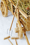 Wooden hay cart on a white background. Forks and rakes Royalty Free Stock Photography
