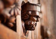 Wooden head on the door Stock Photos