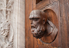 Wooden head and marble grapes. Wooden headand marble grapes  on the gate of Basilica di Santa Croce (Basilica of the Holy Cross) in Florence Italy Stock Images
