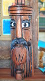 Wooden head with a pipe Stock Images