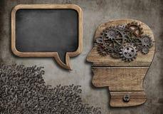 Wooden head with speech bubble. Blackboard stock illustration