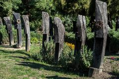 Wooden headstones in the graveyard. Traditional burial ceremony stock photos