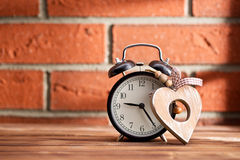 Wooden heart and alarm clock Royalty Free Stock Photo