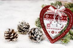 Wooden Heart And Pine Cones On A Snow Royalty Free Stock Images