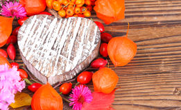 Wooden heart and autumn fruits Royalty Free Stock Photos