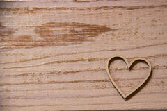 Wooden heart on wooden background stock photo