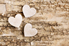 Wooden heart on bark background. Symbol of love Royalty Free Stock Photos