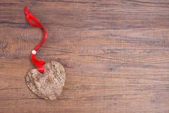 Wooden heart with bark Stock Photography