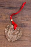 Wooden heart with bark in vertical format Royalty Free Stock Photography