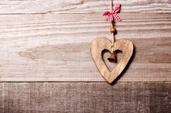Wooden heart with bell decoration on vintage oak background, spa Stock Photos