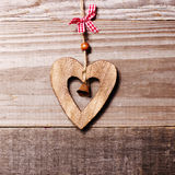 Wooden heart with bell decoration on vintage oak background, spa Royalty Free Stock Photo
