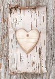 Wooden heart with birch bark on the old wood Royalty Free Stock Images