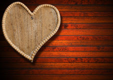 Wooden Heart on Brown Wood Background Stock Images