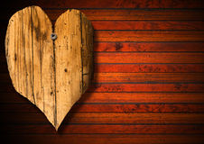 Wooden Heart on Brown Wood Background Stock Image