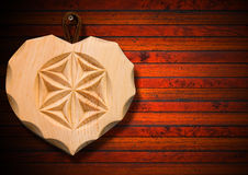 Wooden Heart on Brown Wood Background Royalty Free Stock Photos