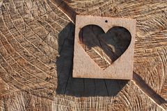 Wooden heart on an cracked surface. Wooden heart on an old cracked surface Stock Photos