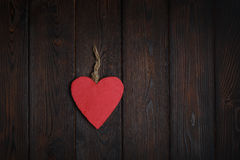 Wooden heart on dark wood background Royalty Free Stock Image