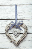 Wooden heart decoration on the white background Royalty Free Stock Image