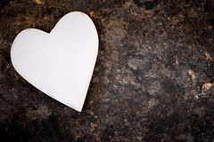 Wooden heart on rusty table, copyspace Stock Images