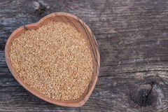 Wooden heart dish with flax seeds Stock Image