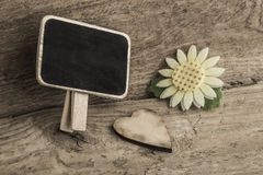 Wooden heart and an empty chalkboard Royalty Free Stock Photo