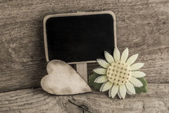 Wooden heart and an empty chalkboard Royalty Free Stock Images