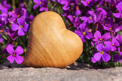 Wooden heart with flowers Stock Images
