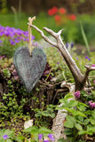 Wooden heart in front of a romantic rustic garden Stock Photo