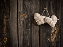 Wooden heart hanging on a branch Royalty Free Stock Images